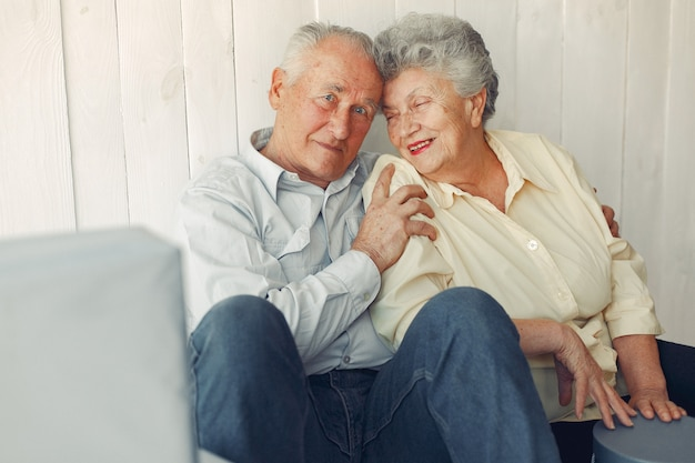 Elegant old couple sitting at home on a foor Free Photo