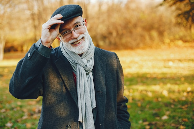 Elegant old man in a sunny autumn park Free Photo