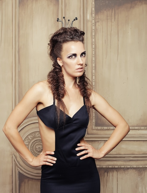 Elegant queen in black dress Premium Photo