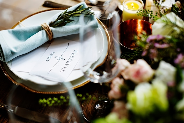Elegant restaurant table setting service for reception with reserved card Premium Photo