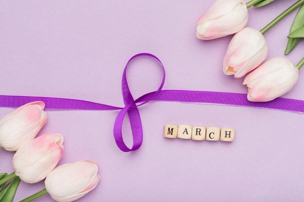 Elegant ribbon symbol and flowers Free Photo