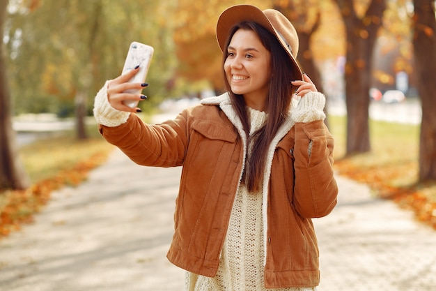 Elegant and stylish girl in a autumn park Free Photo
