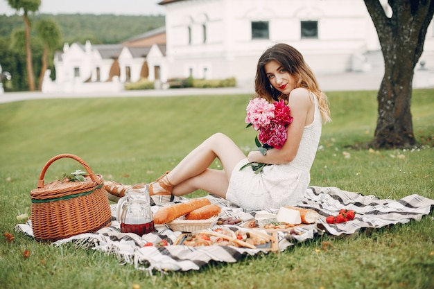 Elegant and stylish girl in a summer garden Free Photo