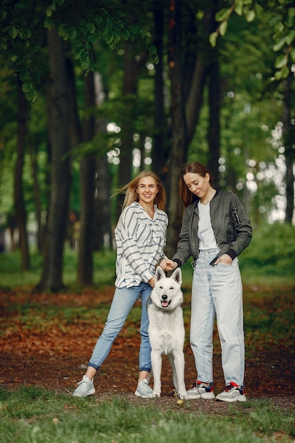 Elegant and stylish girls in a forest Free Photo