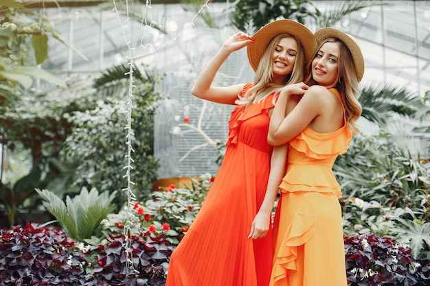 Elegant and stylish girls in a greenhouse Free Photo
