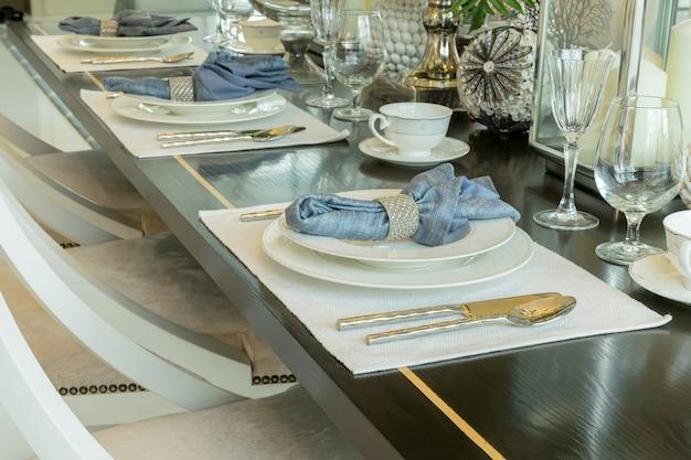 Elegant table set in classic style dining room interior Premium Photo