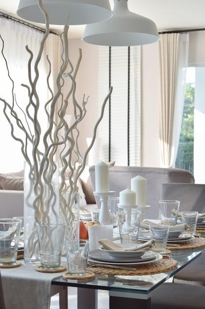 Elegant table set in modern style dining room interior Premium Photo
