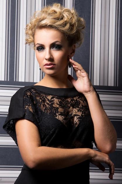 Elegant woman in black dress Free Photo