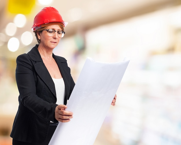 Elegant woman examining blueprints Free Photo