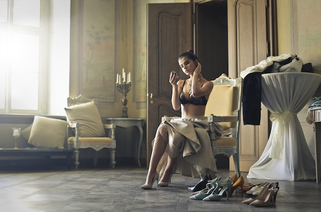 Elegant woman in a luxurious interior Premium Photo