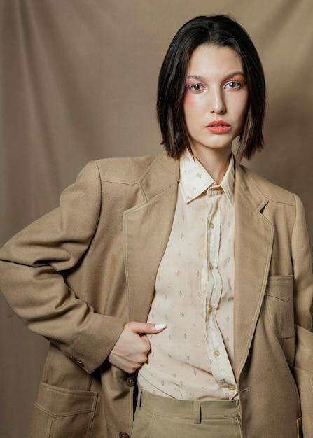 Elegant woman posing in classic suit Free Photo