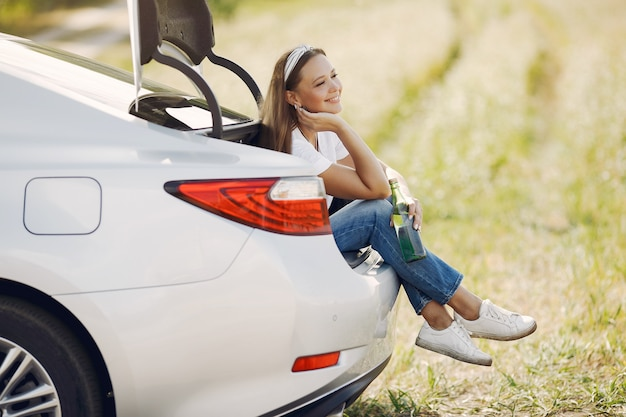 Elegant woman sitting in a trunk with water Free Photo