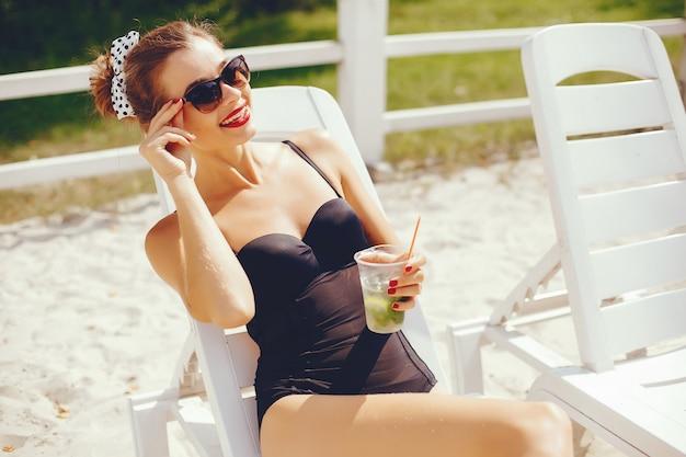 Elegant woman in a sunny beach Free Photo