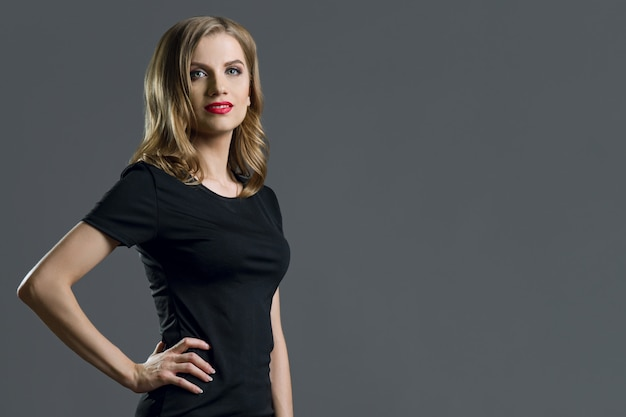 Elegant young business woman blond in black dress Premium Photo