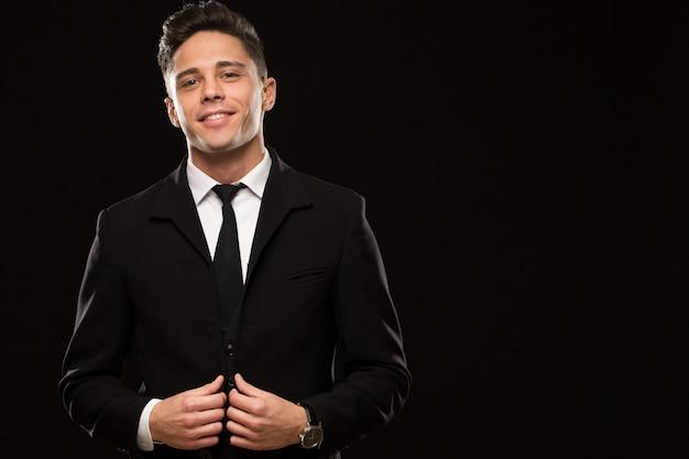 Elegant young man at studio Premium Photo