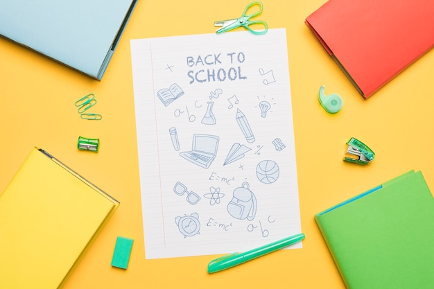 Elements of studying painted on paper with writing back to school Free Photo