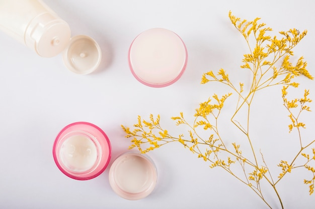 Elevated view of body lotions on white background Free Photo