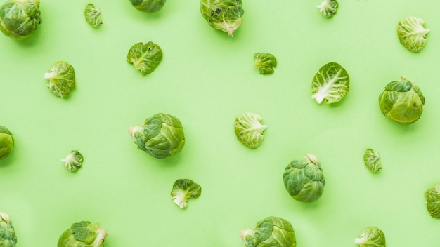 Elevated view of brussels sprouts on green backdrop Free Photo