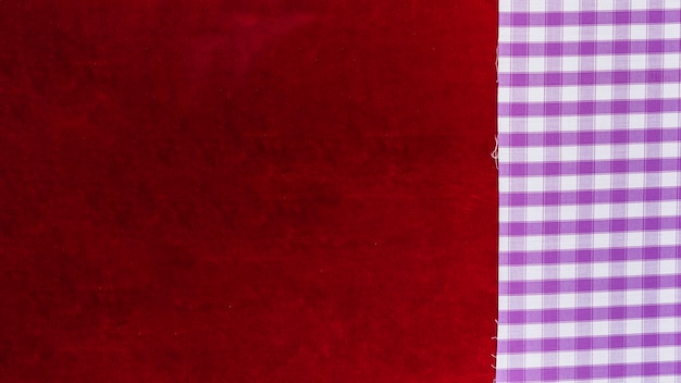 Elevated view of chequered pattern textile and plain burgundy fabric Free Photo