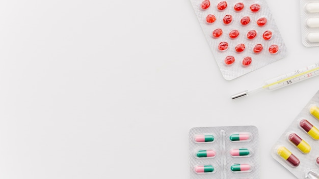 An elevated view of colorful pills on white background Free Photo