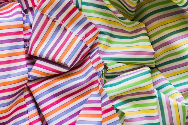 Elevated view of colorful stripes pattern fabric Free Photo