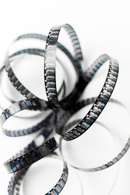 An elevated view of curve film stripe on white background Free Photo