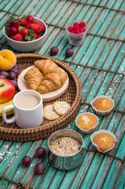 Elevated view of delicious breakfast on wooden surface Free Photo