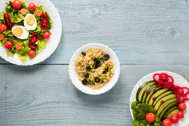 Elevated view of different types of healthy foods with boiled egg and fresh vegetables Free Photo
