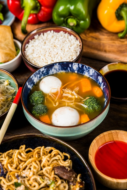 An elevated view of fish ball soup with rice; sauces and noodles Free Photo