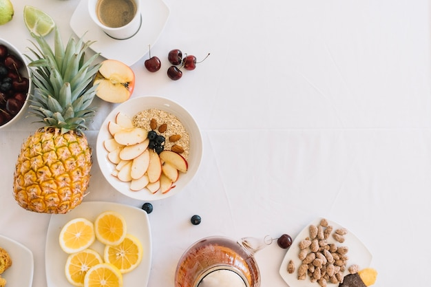 Elevated view of fresh healthy breakfast on white background Free Photo