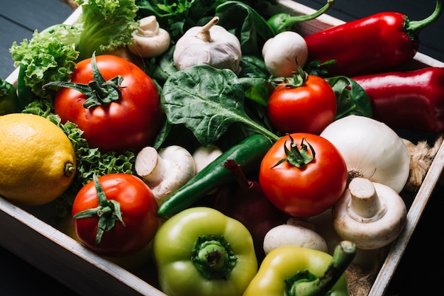 Elevated view of fresh organic vegetables in container Free Photo