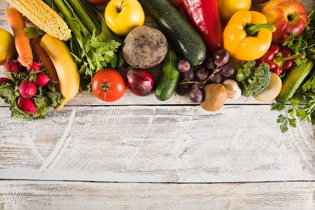 Elevated view of fresh vegetables on wooden plank Free Photo