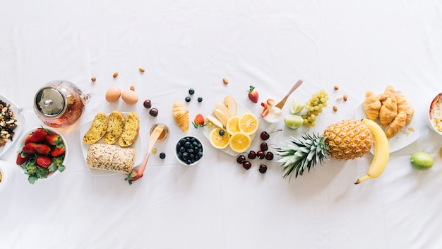 Elevated view of healthy breakfast on white background Free Photo