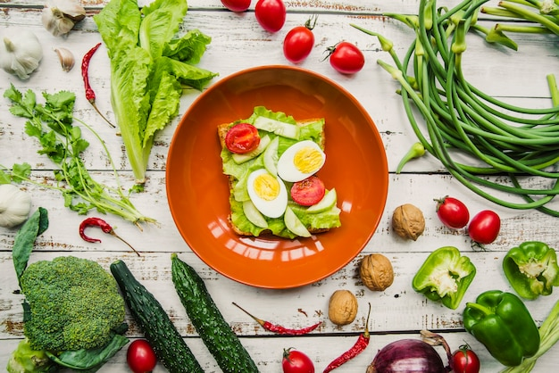 Elevated view of healthy egg and vegetables sandwich in bowl Free Photo