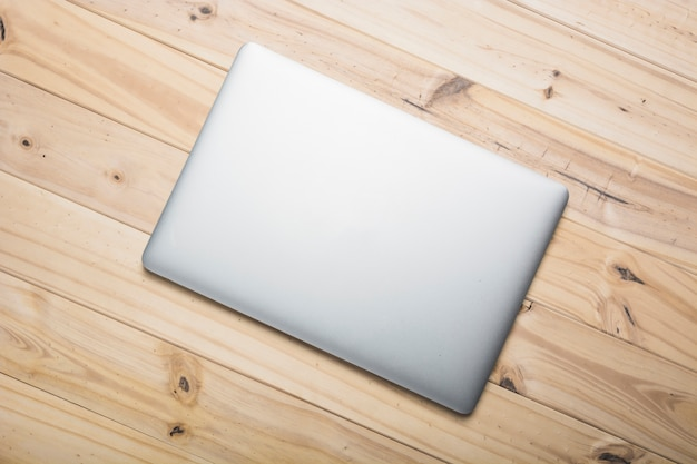 Elevated view of a laptop on wooden plank Free Photo