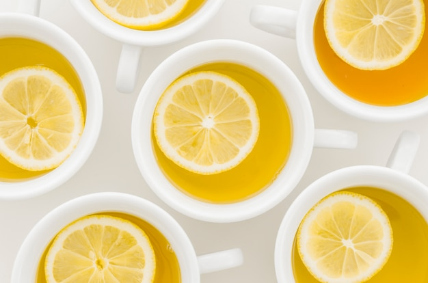 An elevated view of lemon tea cup isolated on white background Free Photo