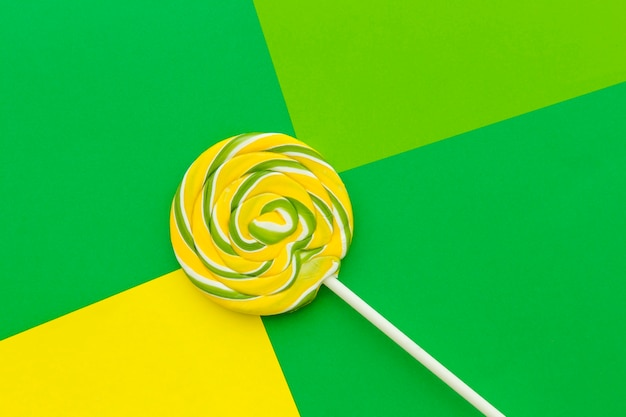 Elevated view of lollipop on colorful background Free Photo