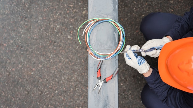 Elevated view of male electrician at work Free Photo