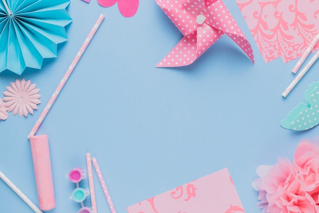 free photo elevated view of origami crafts art and straw on blue background elevated view of origami crafts art