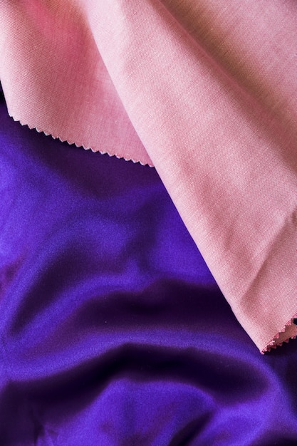 Elevated view of pink and purple fabric material Free Photo