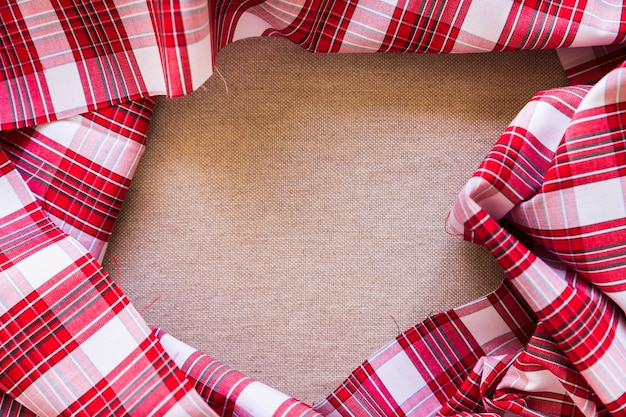 Elevated view of red chequered cloth forming frame Free Photo