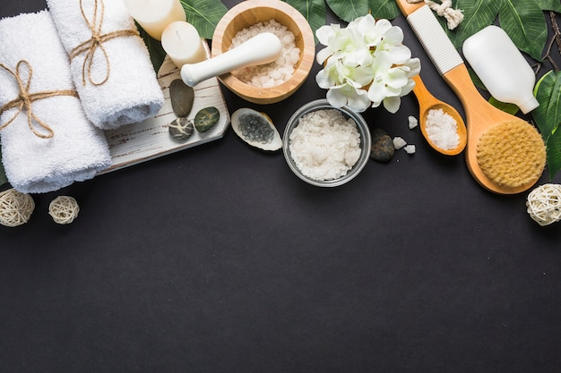 Elevated view of spa products on black backdrop Premium Photo