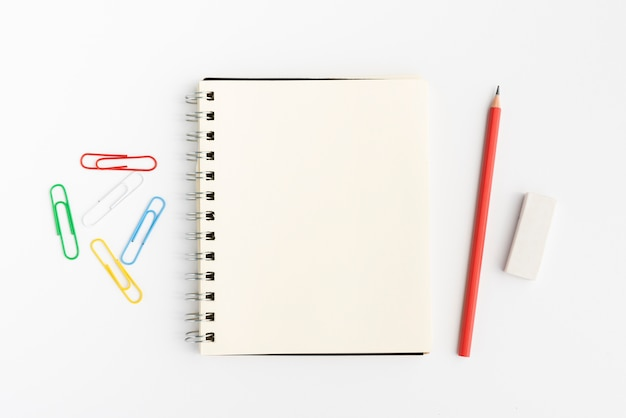 Elevated view of stationery product on white surface Free Photo