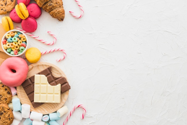 Elevated view of unhealthy food on white background Free Photo