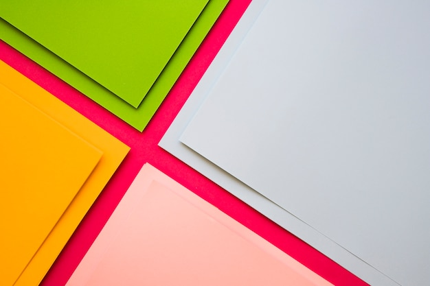 Elevated view of various multi colored cardboard papers Free Photo