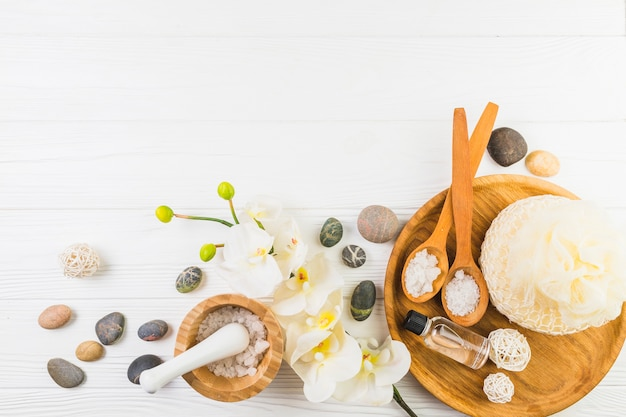 Elevated view of various spa products on wooden background Free Photo