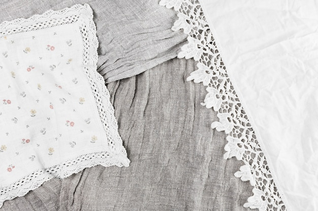 Elevated view of various textile with lace ribbon Free Photo