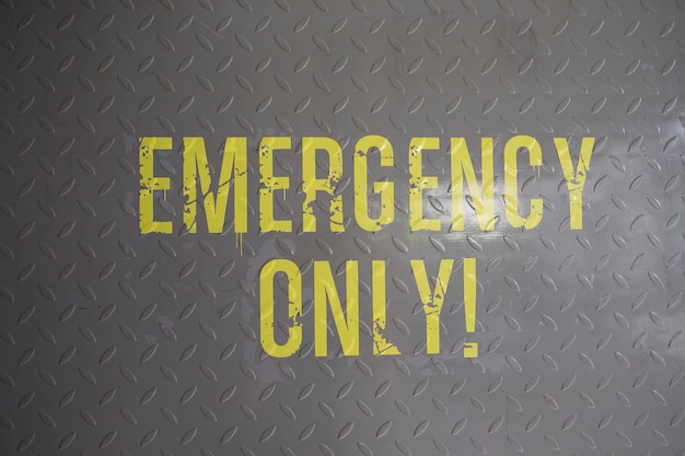 Emergency only sign on floor Free Photo