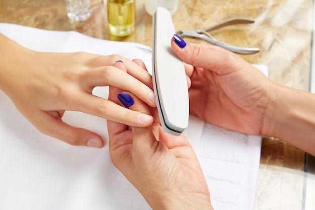 Emery polish sandpaper woman nails salon Premium Photo