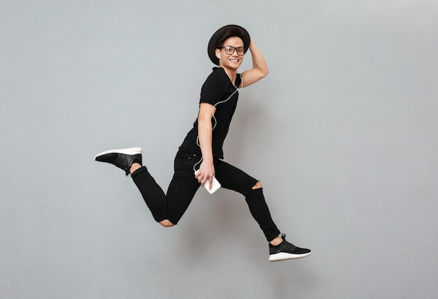 Emotional young asian man jumping isolated Free Photo